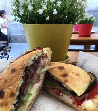 Una Puccia. A puccia being a bread roll that resembles a little cheek that you fill with meats, cheeses and vegetables as desired. A local lunch favourite.