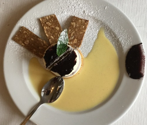 A divine desert based on olives: olive paste (sweetened), olive oil mousse. The almond biscuits were buttery and crisp. The creme anglaise added enough sweetness.