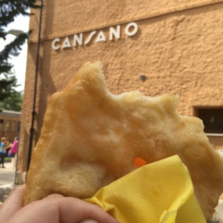 Homemade pizza fritta, a fried pizza dough at Cansano Station